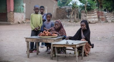 Children set up a stall to sell their wares to early morning passers-by in the town of Kouango,Central African Republic. Photo: Kieran McConville / Concern Worldwide