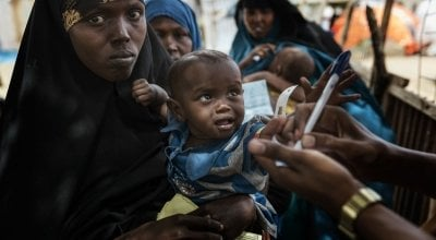 Mother and child queue for medical care in Refugee Camp near Mogadishu. Photo: Marco Gualazzini/ Concern Worldwide