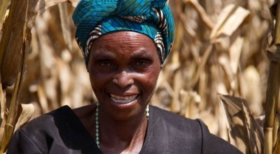 Doris Malinga showing her plot of land which she farmed using the conservation agriculture method, Kabudula, Lilongwe District, Malawi. Photo: Jennifer O'Gorman/ Concern Worldwide.