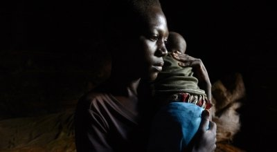 Aline Nsabimana is worried about her three-month-old son Roger – her only child, after a fever broke out and he began coughing during the night. Photo: Chris de Bode/Panos Pictures for Concern Worldwide