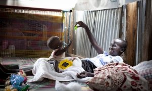 Dehlia* with her sister Koaloch* hang out in the mother and baby room in the Concern Worldwide Nutrition Clinic in a POC in Juba, South Sudan. Photo: Abbie Trayler-Smith