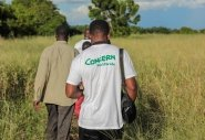 Concern team member, Sam (26) takes a camera to document the damage to crops in Nsendje.  Photo: Gavin Douglas/Concern Worldwide